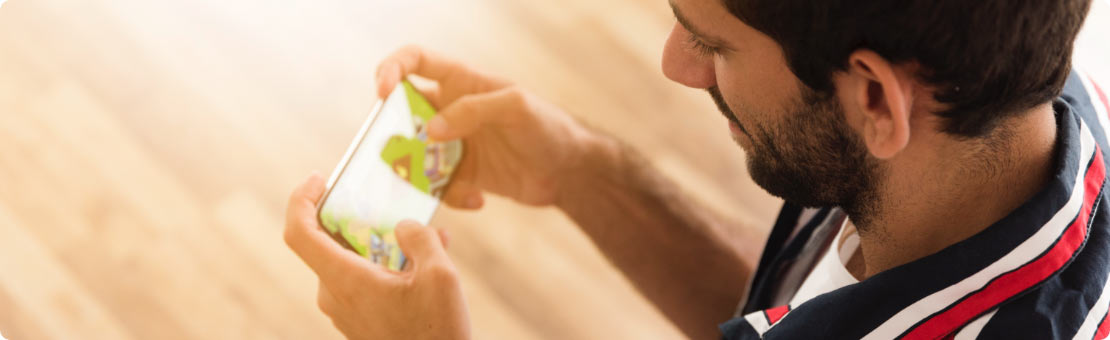 user playing mobile online games